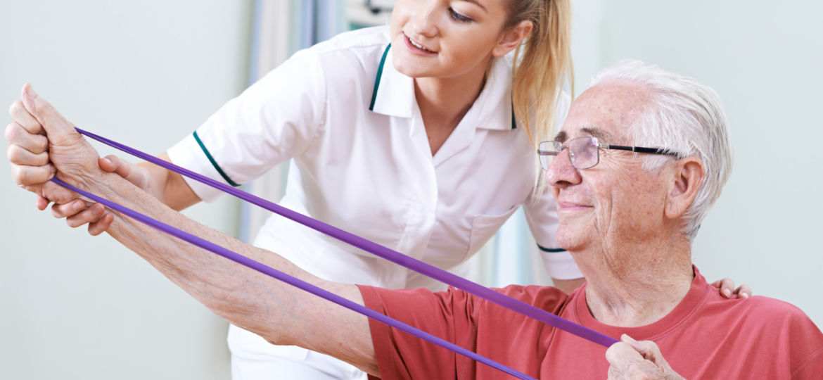 in-home nurse helping elderly senior man