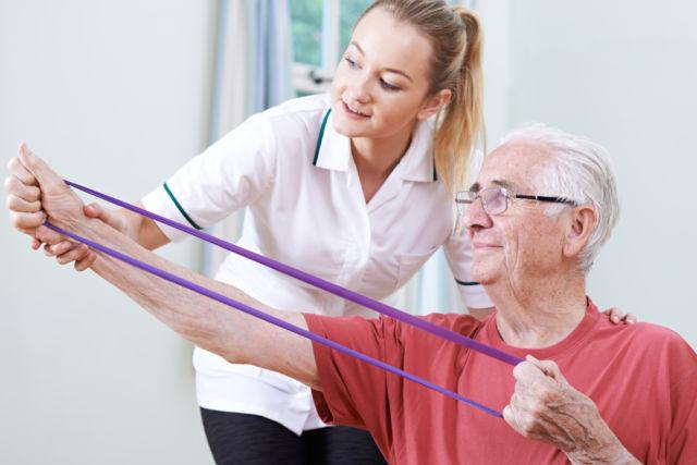 in-home nurse helping elderly senior man