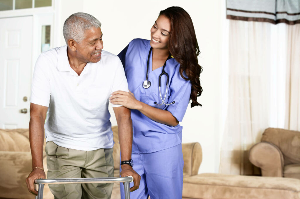 home health care worker helping elderly man